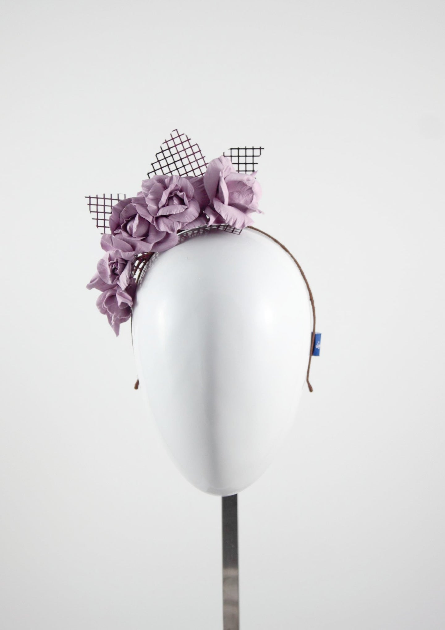 Leather roses on headband with reflective lattice detail. Millinery handmade in London. Front view. Pink side view