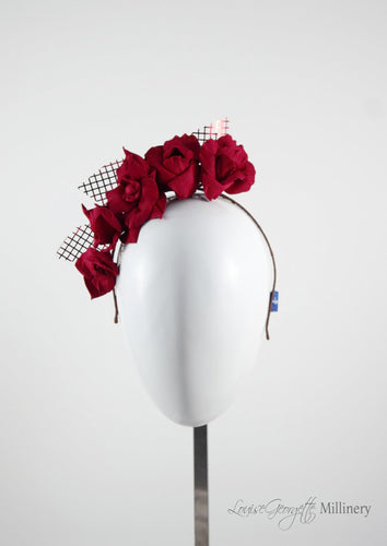 Patterned Leather roses on headband with reflective lattice detail. Millinery handmade in London. Front view.