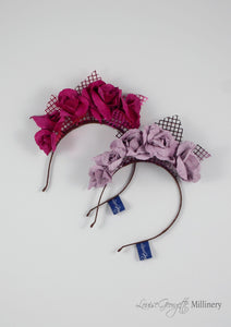 Leather roses on headband with reflective lattice detail. Millinery handmade in London. Flat top view. Pink and Lilac