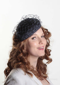 Frenchie Navy waffle beret, handmade in London. Model side view. Louise Georgette Millinery