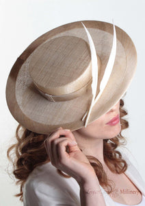 Harper natural and cream boater with two quills. Millinery handmade in London. Side close up view with model.