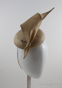 Gold straw button hat with twisted tie, side view.
