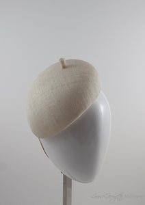 Ivory straw beret hat with. Suitable for bridal wear or royal ascot.
