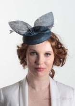 Blue pinokpok pillbox with bow and feather detail. Handmade Millinery made in London - Louise Georgette Millinery Front view.
