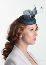 Blue pinokpok pillbox with bow and feather detail. Handmade Millinery made in London - Louise Georgette Millinery side view.