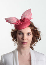 Hayley small disc Hat with bow detail in natural straw. Model front view. Hand