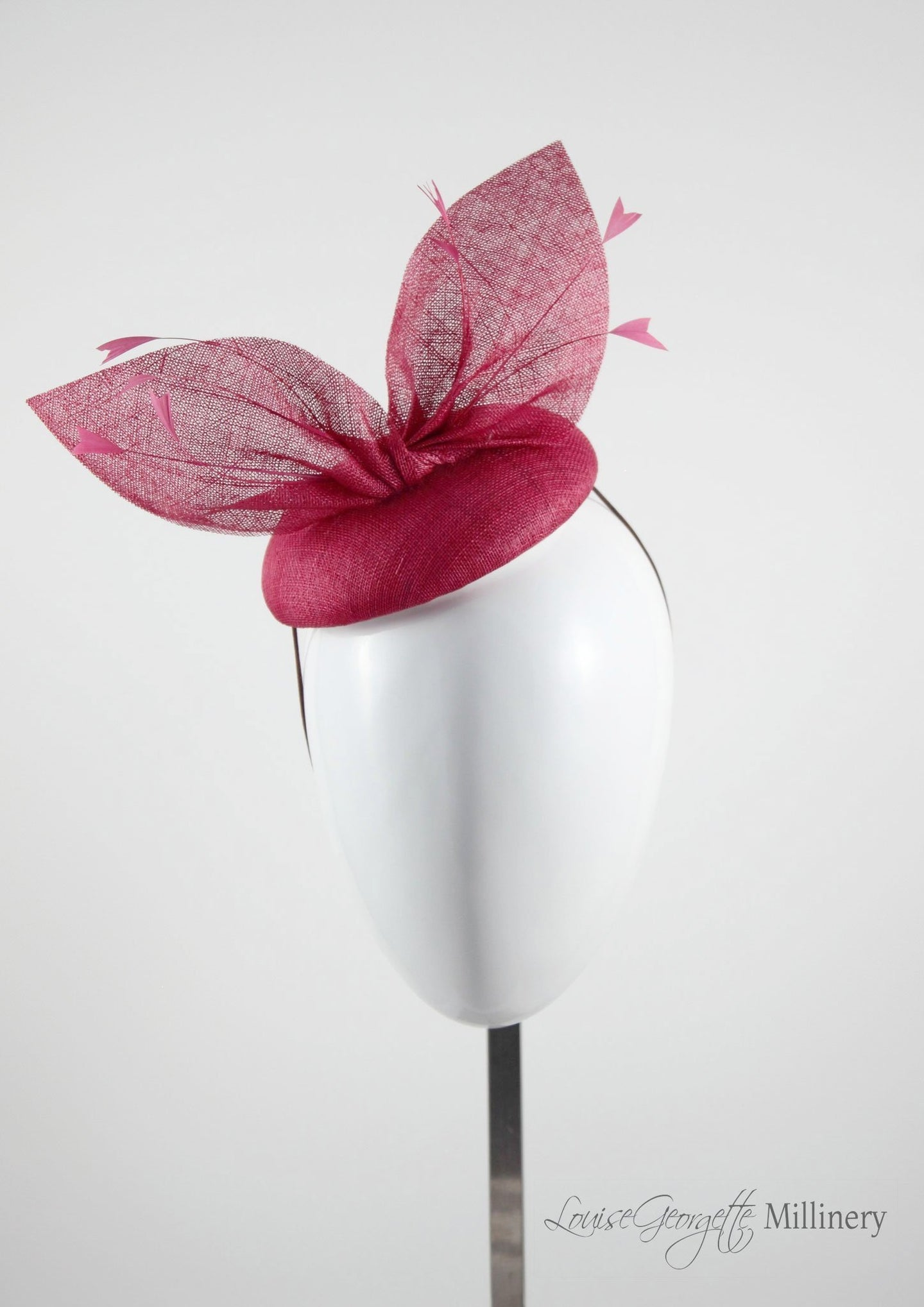 Red straw bow hat with feathers.Front view. Royal Ascot, Royal enclosure approved. Millinery handmade in London. Louise Georgette Millinery