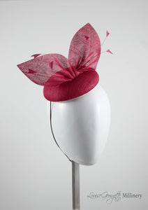 Ice Blue straw bow hat with feathers.Side view. Royal Ascot, Royal enclosure approved. Millinery handmade in London. Louise Georgette Millinery