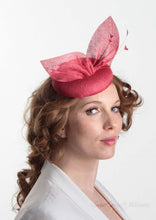 Hayley small disc Hat with bow detail in red straw. Model side view. Hand