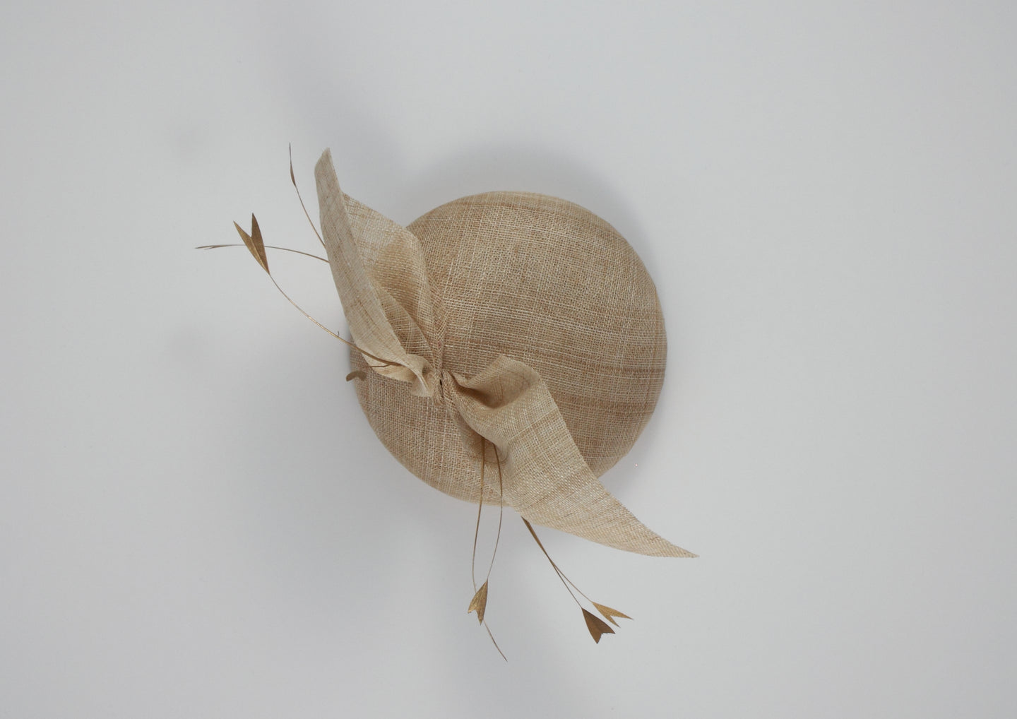Beige / Natural straw hat with gold feathers. Suitable for weddings, special occasions and race days. A popular straw style, our signature fun and timeless hat suits most face shapes and can be made in bespoke colours upon request.