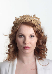 Lacey tiara style gold  crown on headband. Model front view. Millinery handmade in London.
