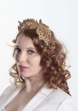 Lacey tiara style gold  crown on headband. Model second side view. Millinery handmade in London.