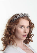 Ivory and Brown/Black stripped feather headband. Model side view. Handmade millinery made in London.