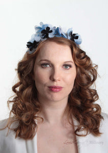 Sylvie metallic blue flower crown. Model front view. Millinery handmade in London. Louise Georgette Millinery.