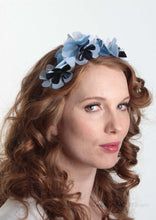 Sylvie metallic blue flower crown. Model side view. Millinery handmade in London. Louise Georgette Millinery.