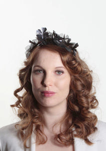Front facing view. Sylvie metallic flower crown in black and gunmetal