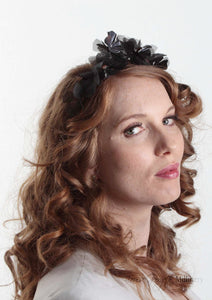 Side facing model in  Sylvie metallic flower crown in black and gunmetal