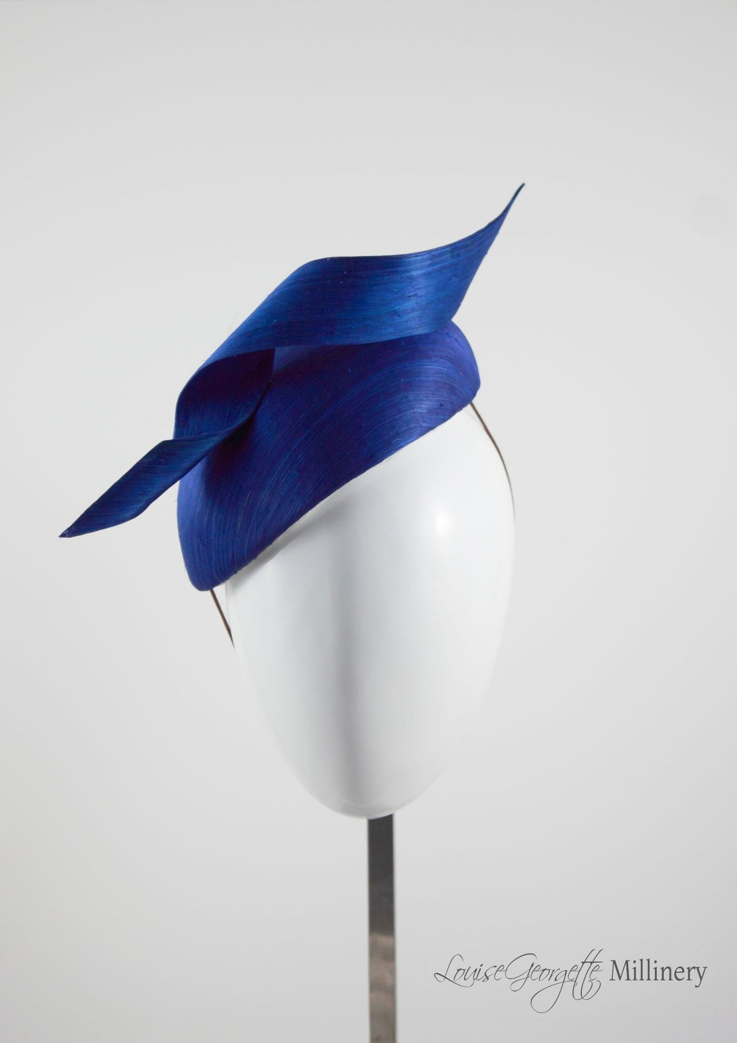 Side view, Silk Navy Beret hat with twist detail. Handmade in London, Millinery suitable for racing, weddings and other special occasions.