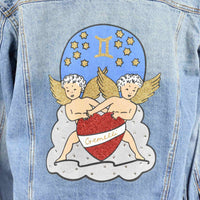 Disegno Mio womens Gemini 'Gemelli' printed mid wash denim jacket embellished with Swarovski® crystals
