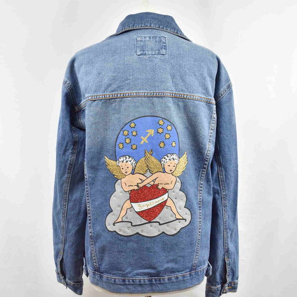 Disegno mio womens Sagittarius 'Sagittario'  printed mid wash denim jacket embellished with Swarovski® crystals
