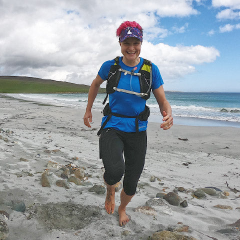 Anna McNuff running on the beach in Crewroom Clothing
