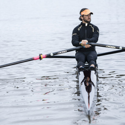 Man in a rowing boat wearing Crewroom's Team Clothing
