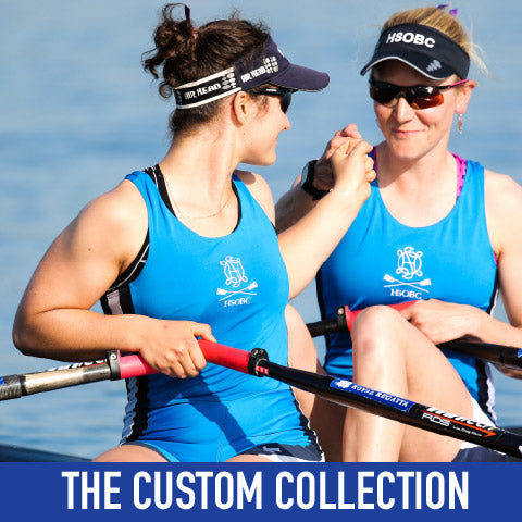 Two women on a rowing boat wearing Crewroom's Team Clothing