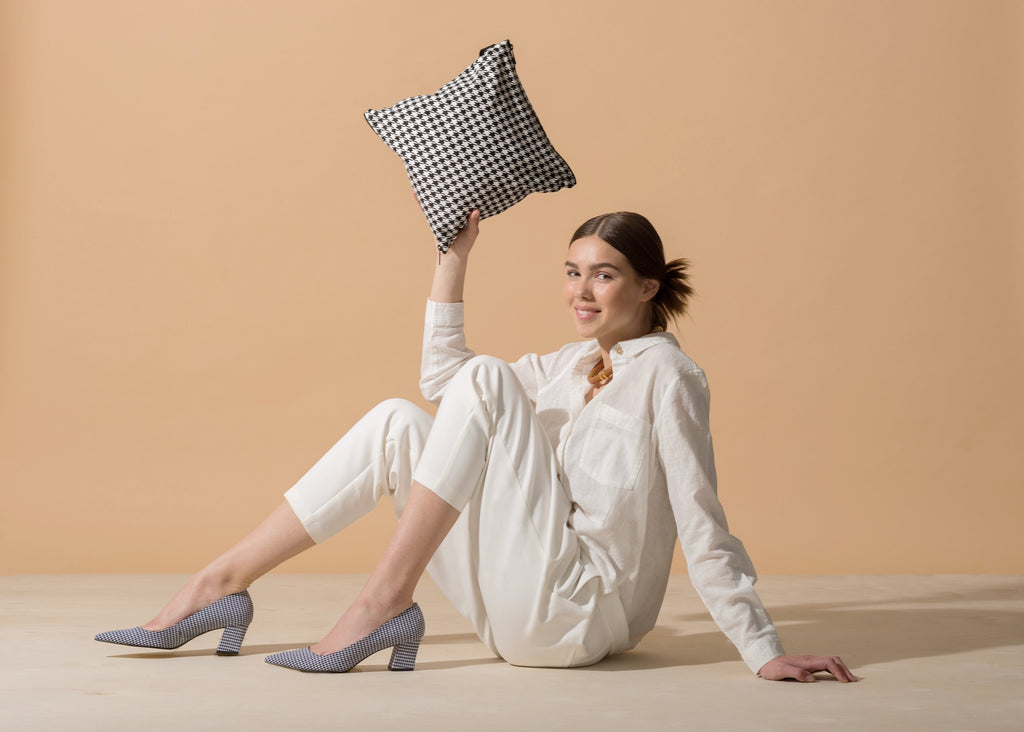 Model holding SHOOFIE shoe bag in Royal Houndstooth print