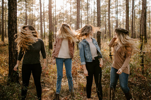 4 girls in the woods shaking their hair