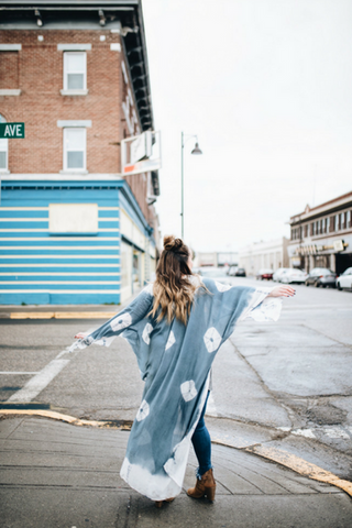 Bailey from Every Step twirling in an Indigo tie-dye patterned Kimono from Indigo Lane, a modest clothing boutique in Rexburg Idaho