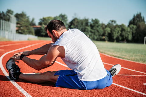 Man stretching on the track