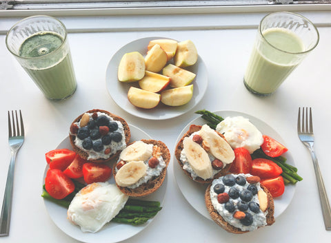 A breakfast with fruit, toast, eggs, and juice