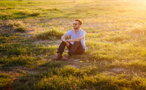 Man sitting on the grass relaxing
