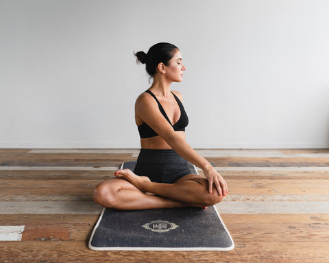 Woman on a yoga mat stretching