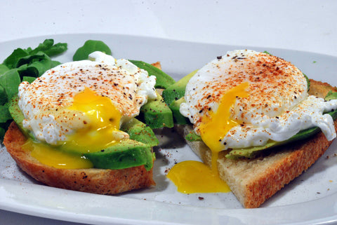 Runny eggs over spinach and toast