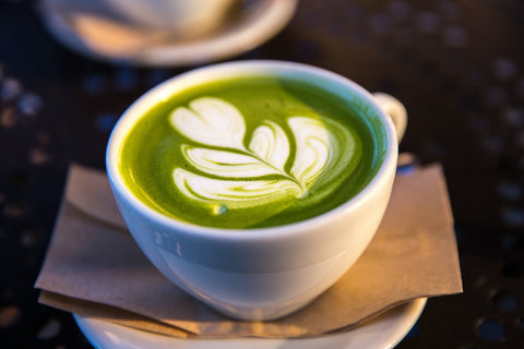 Cup of matcha tea with latte art