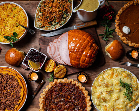 Holiday meal with ham and other dishes