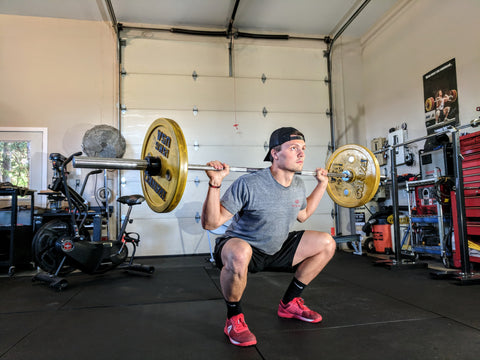 Man doing a squat with bar weights
