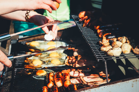 Barbeque with different types of food on the grill