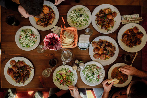 Family dinner table with many dishes