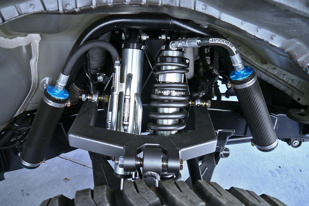 King Coilover shocks and springs with reservoirs, including a secondary external bypass shock with reservoir