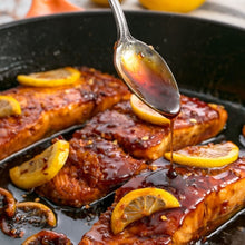 Raw Local Honey infused with Organic Cayenne Pepper is sweet and spicy sauce on salmon and fish.