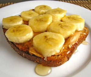 Peanut butter, bananas, and Florida Orange Blossom Honey on toast is delicious!  Just ask Elvis!