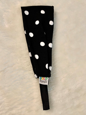 Sporty headband in black with white dots.