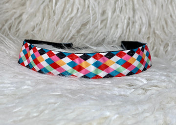 Multi colored bold colored, diamond patterned, adjustable no slip headband.
