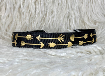 Black with gold arrows adjustable no slip headband.