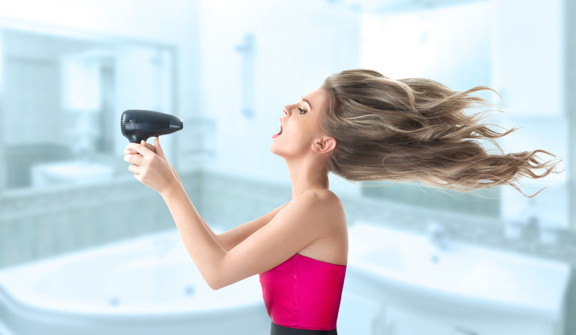 woman holding hair dryer - model image