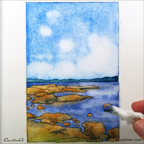 Use wet tissue paper tightly rolled to soak up more blue for the water reflections.