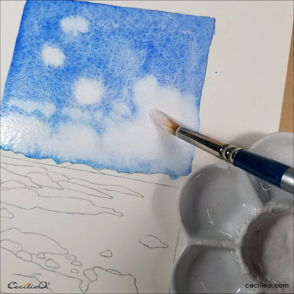 Painting clouds with white gouache.