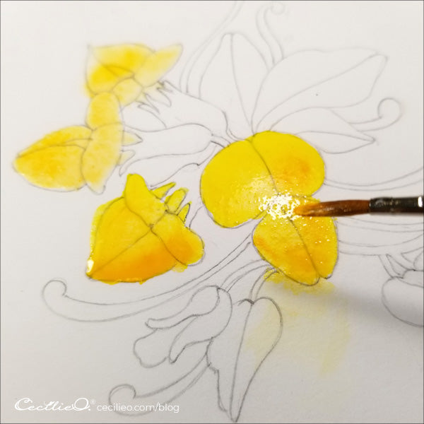 Adding yellow watercolor on the flower petals
